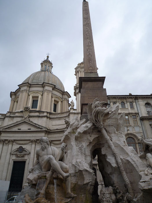 Bernini's fountain with Borromini's church (also cleaned!) behind