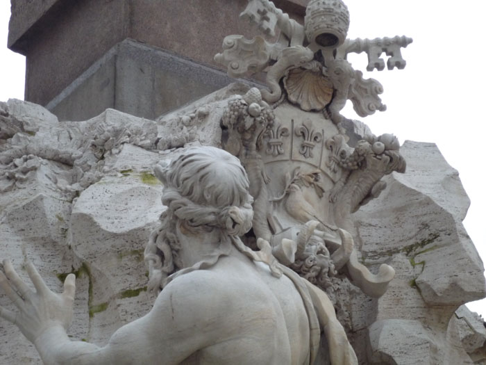 The papal coat of arms on the fountain