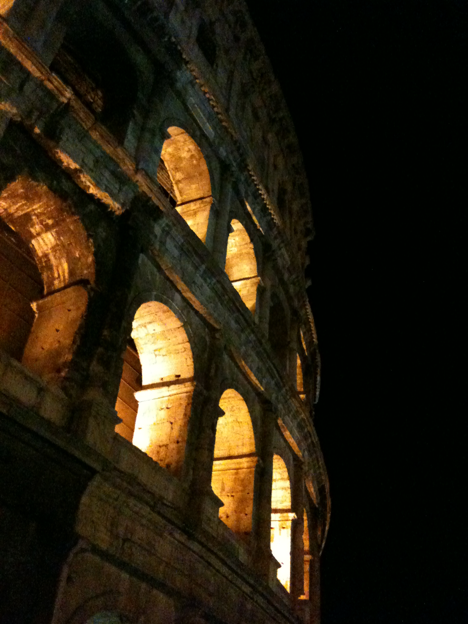 The colosseum is beautifully lit up at night.