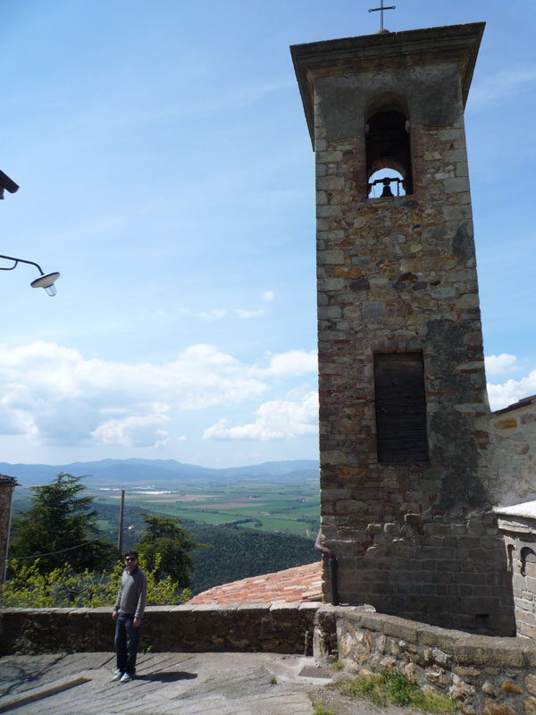 """tommaso's in there """"for scale"""" to show the romanesque church tower in sticciano"""