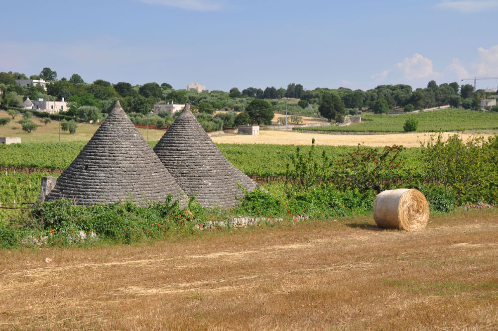 Trulli in the valle d'itria + hay bales.