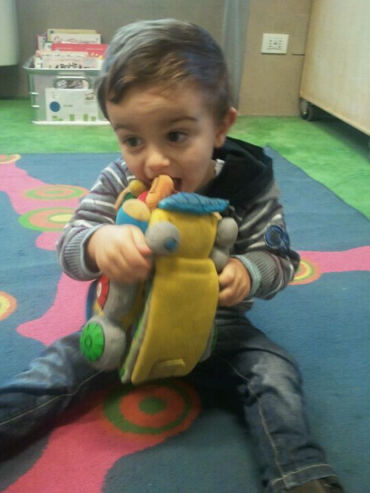 Laura's Francesco at the Oblate Library, eating the free toys.
