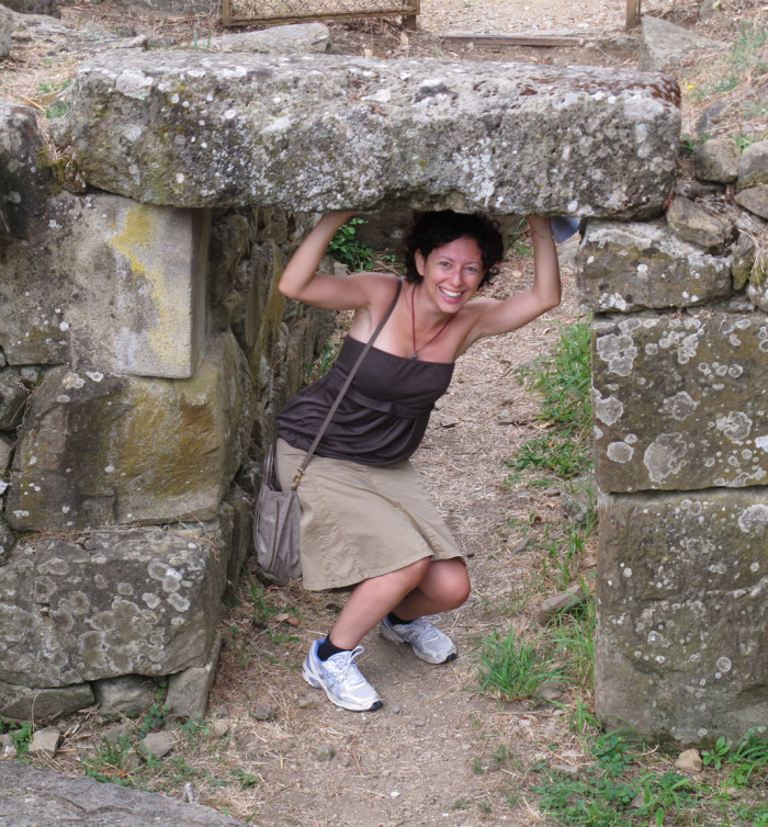 My sister-in-law Laura demonstrates the height of the opening of one of the tombs found down the dirt road.