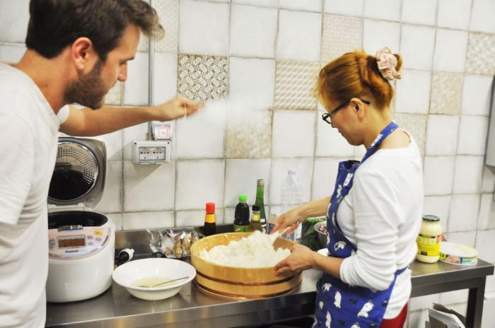Paolo helping fan sushi rice