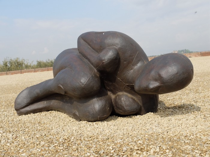 A foetal-position figure cast from the artist's body