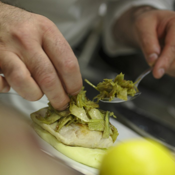 Sea bass with olive oil mashed potatoes and artichokes