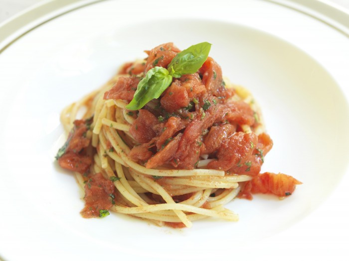 Pierangeli's famous spaghetti and tomato sauce is made by crushing the fruit in his hands.