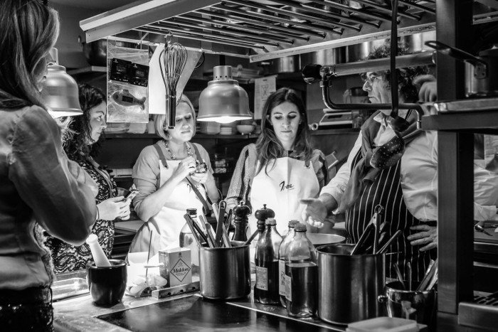 A small kitchen full of bloggers and a famous chef