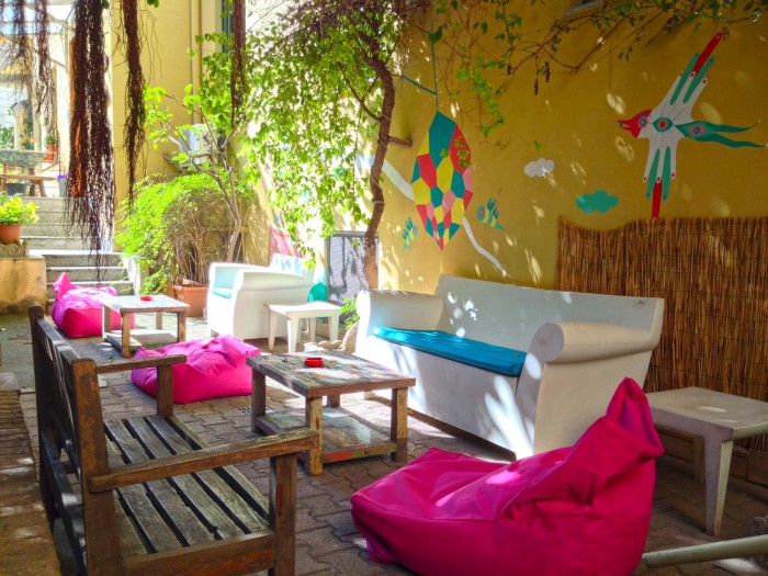 The garden at Beehive Rome, with mural by Gio Pistone