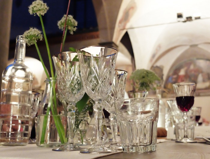Glassware and flowers down the centre of the table