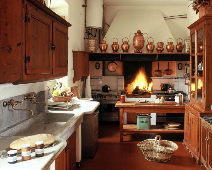 A Tuscan country kitchen with marble countertops at Marsiliana Estate in the Maremma