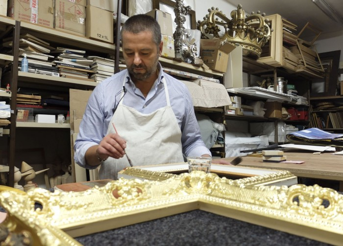 Gabriele demonstrating gold leaf application in his workshop