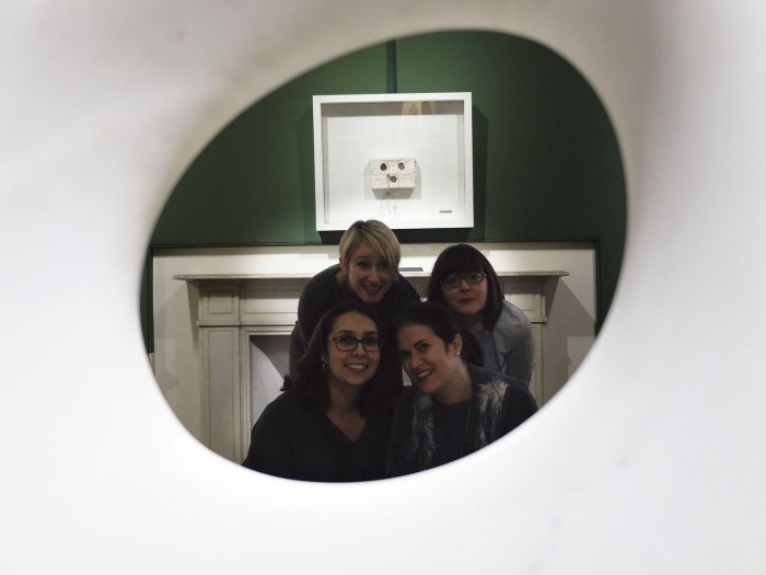 Four bloggers who could not resist posing within the marble piece by Kan Yasuda