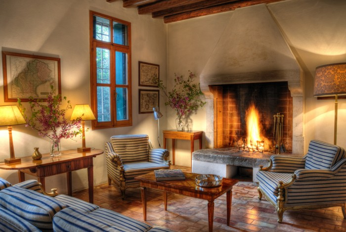 Warm winter reading by the fireplace in this Veneto Villa