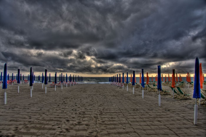 Viareggio storm on the beach| Photo flickr user @rabendeviaregia