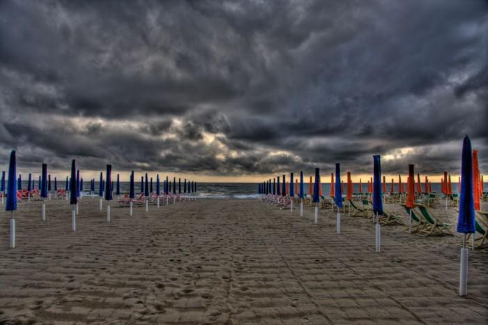 Viareggio storm on the beach| Photo flickr user @rabendeviaregia