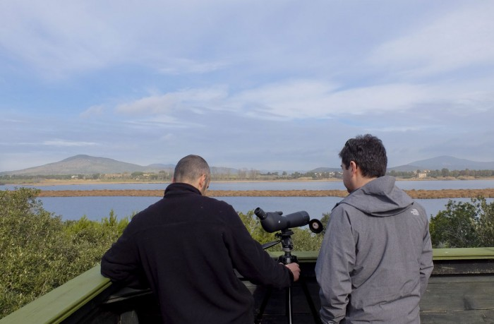 Our guide and Tommaso with a powerful monocular on a high observatory over Lago di Burano | Photo AMK