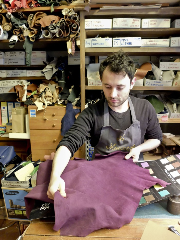 Giovanni Lorenzo shows me the softest suede for women's boots
