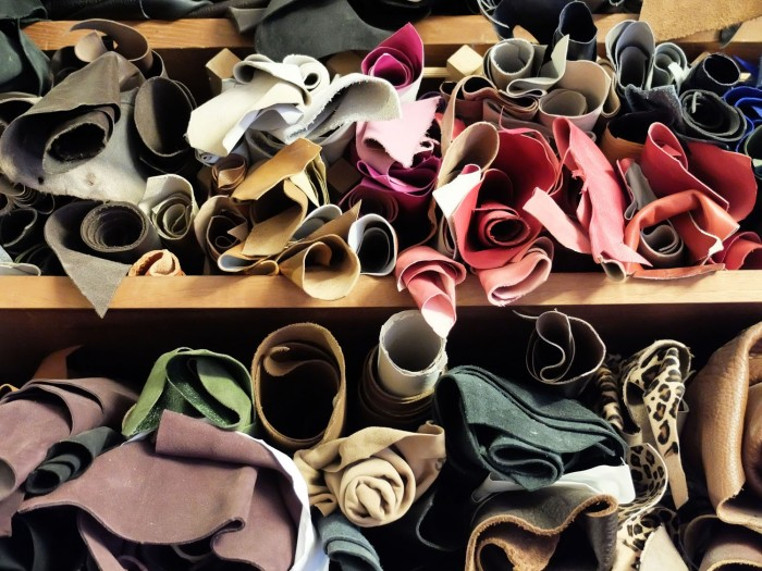 Rolls of colourful and marvelously soft leather line the shelves