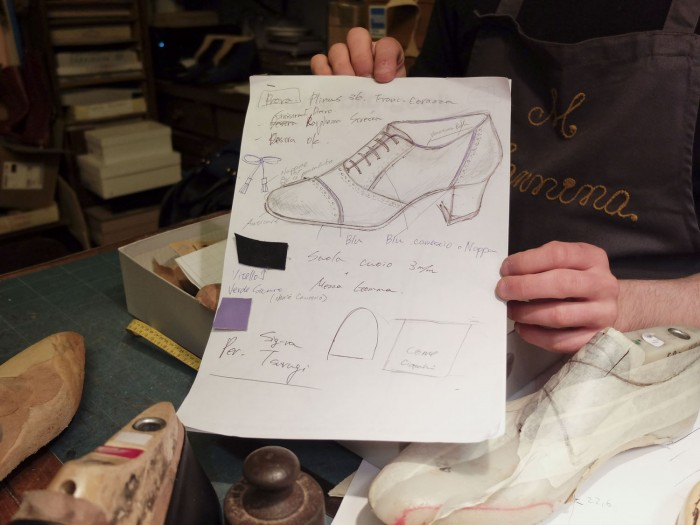 Giovanni shows me a drawing made to illustrate the client's desires