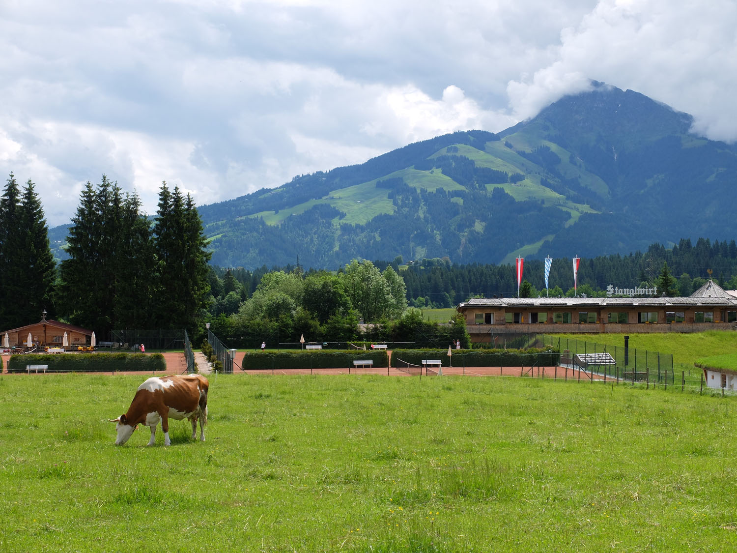 Pastures, tennis courts, and the new expansion of Stanglwirt, with the Kaiser mountains