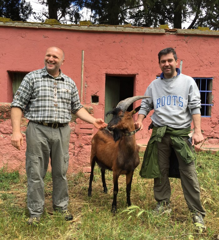 Tommaso getting friendly with the goats and farmer where we buy cheese in Maremma