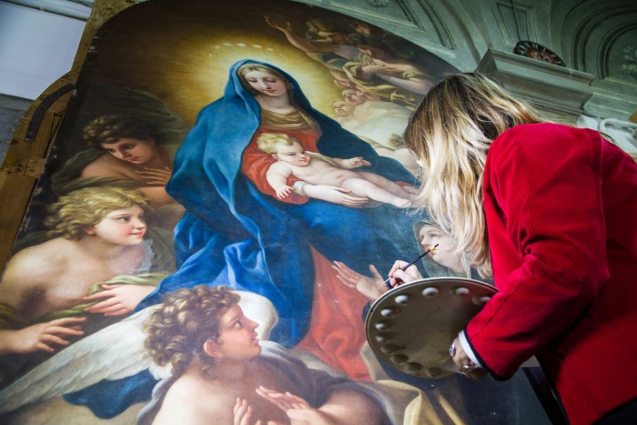 Restorers at work on Violante's painting