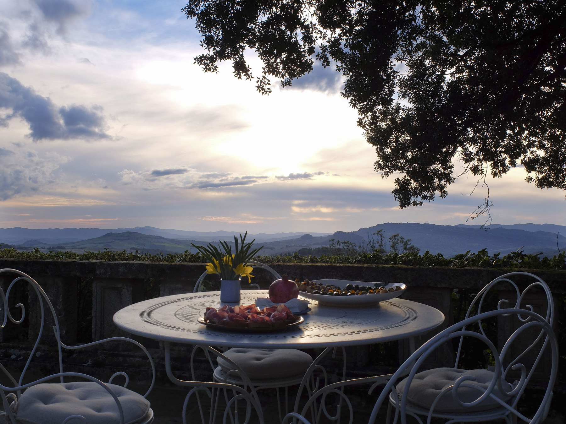 Sunset aperitivo in the garden overlooking the hills of Volterra