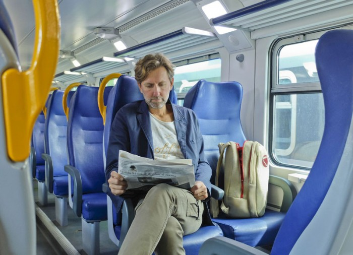 My colleague Giovanni reading the newspaper on one of the newer commuter trains