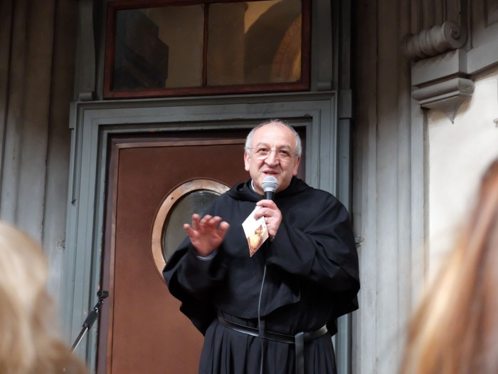 Father Giuseppe speaking about the work