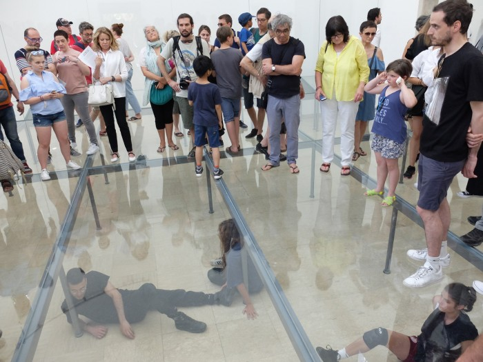 People looking at performance art (German pavilion). But do they understand it? I don't.