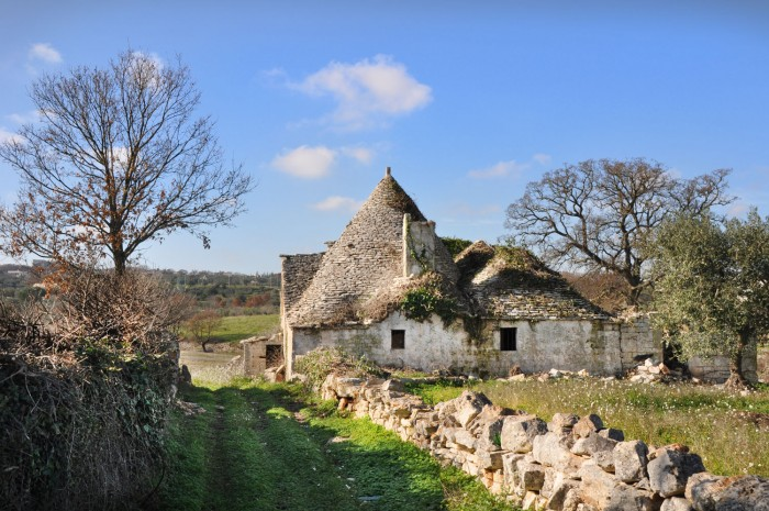 An abandoned trullo in a field in Puglia