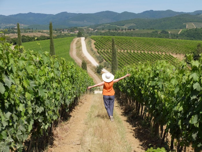 Because if you want pictures like this you need to visit a winery! | Photo by Michelle Davis of me at Dievole in the Chianti Classico area of Tuscany