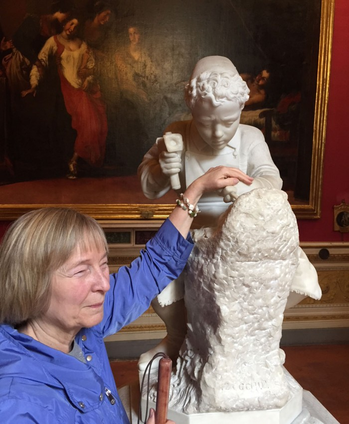 Gayle visiting and touching statues in Florence