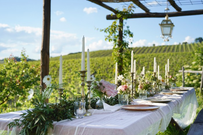A wedding table in the garden set by Puscina Flowers