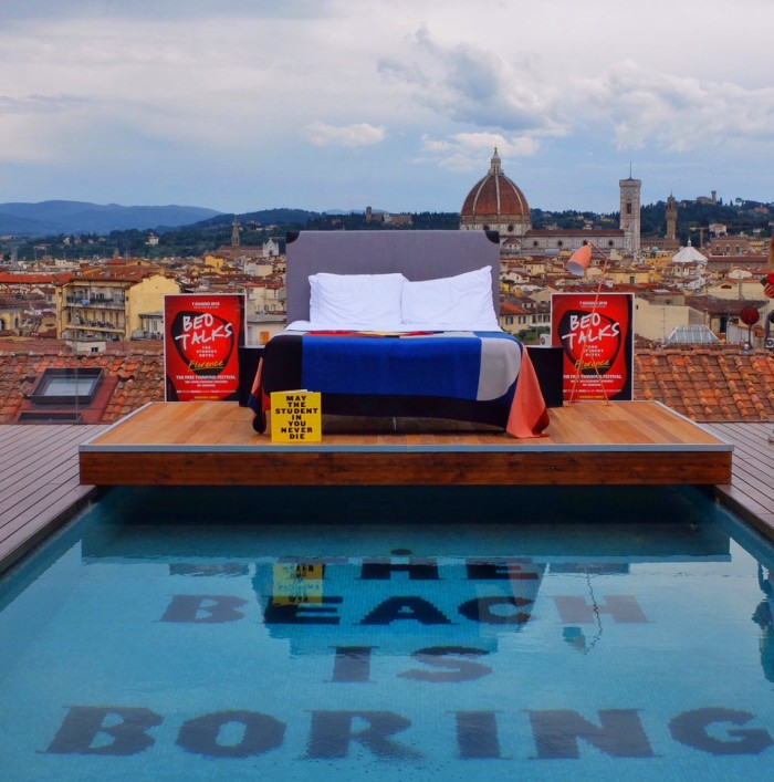 The Student Hotel Florence features a fantastic rooftop pool and double rooms starting at €100! The bed on top was just for an event...