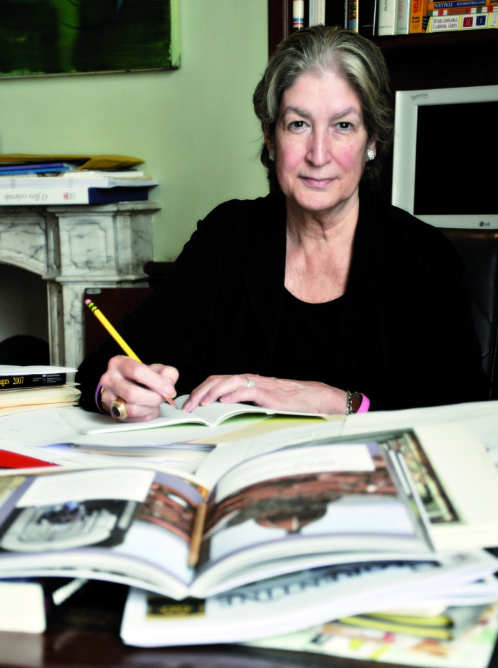 Jane writing, in a photo by Marco Badiani (note The Florentine and other books by TFPress in the foreground)