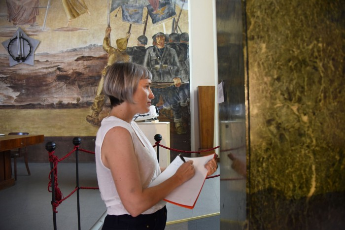 Taking notes in the casa del mutilato | ph. Marco Badiani