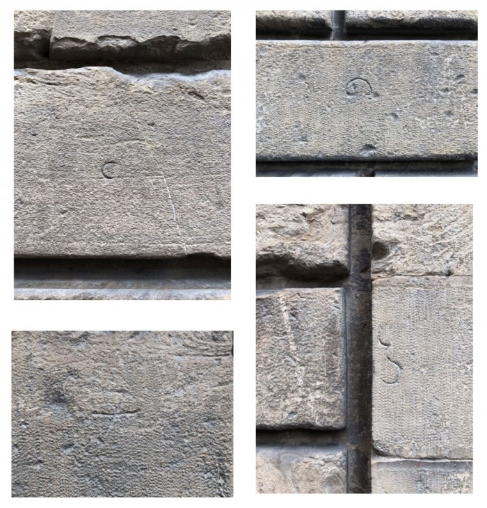 Assorted glyphs carved onto the façade. Photo: Colby Anderson.