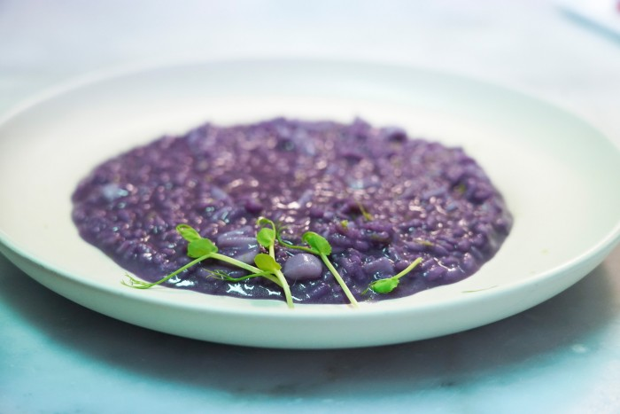 Risotto with red cabbage and calamari, lime zest