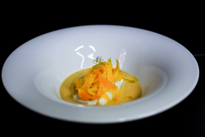 Baccalà cooked under oil, on cream of chick peas, topped with saffron fennel