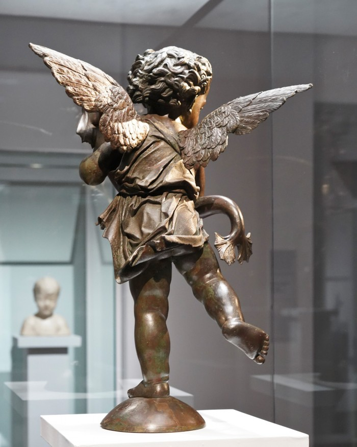 Putto with dolphin by Verrocchio looks at Desiderio's Boy