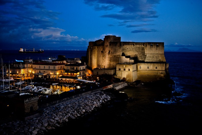 Castel dell'Ovo is located on the seafront of Naples and is gorgeous by night | ph. Flickr user Cliff Hellis